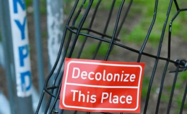 Decolonize this place sign