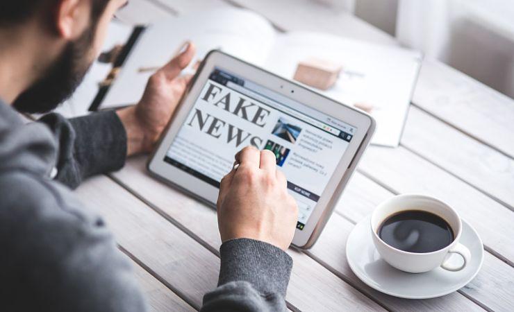 Reading fake news on tablet